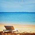 Chaise lounge on a beach Stock Photos