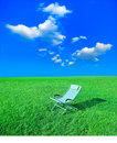 Chaise lounge on the green grass Royalty Free Stock Photos