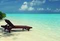 Chaise lounge in the water on the shore of the indian ocean Stock Photography