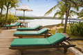 Chaise lounges and kind on ocean gulf, Indonesia Stock Photography
