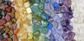 Chakra tumbled healing stones crsytal healing background Royalty Free Stock Photo