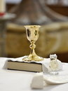 Chalice bible and holy water christian accessories baptismal in a pitcher Stock Photos