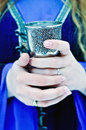 Chalice in hands of woman at winter Royalty Free Stock Photo