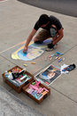 Chalk artist draws portrait on sidewalk at arts festival atlanta ga usa june a sketches a a the old fourth ward to promote an art Royalty Free Stock Images