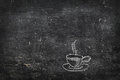 Chalk on black board cup of tea of coffee blackboard Royalty Free Stock Photography