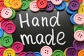 Chalk Board with the inscription `manual discount` surrounded by colorful wooden buttons Royalty Free Stock Photo