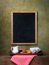 Chalk board menu and breakfast on a tray Royalty Free Stock Photo