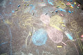Chalk drawings made by children on asphalt and pieces of Royalty Free Stock Images