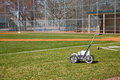 Chalk line machine on baseball field a with fresh lines and the used to spread them Stock Photo