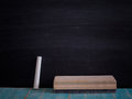 Chalk rubbed out and brush delete board on blackboard backgroun