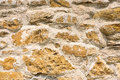 Chalk wall background closeup image of old castle or fortress stone made from rocks old building and textures Royalty Free Stock Images