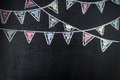 Chalkboard background with drawing bunting flags. Royalty Free Stock Photo