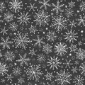 Chalkboard black and white snowflakes seamless vector pattern background with drawn on light sky background Stock Photography