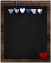 Chalkboard blue and red gingham love valentine s hearts hanging heart on wooden frame with blackboard dotted heart in corner copy Stock Images