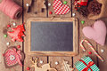 Chalkboard with christmas decorations on wooden background view from above Stock Photo