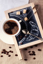 Chalkboard with coffee and sugar top view on cup of on spoon painted croissant over textile tablecloth see series Royalty Free Stock Image