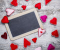 Chalkboard with felt hearts used as a symbol of love Stock Photo