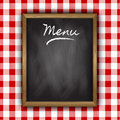 Chalkboard menu design on a gingham patterned background Stock Photos