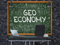 Chalkboard on the Office Wall with Geo Economy Concept. 3D.
