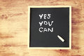 Chalkboard with the phrase yes you can