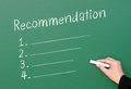 Chalkboard recommendation checklist green with a blank list of numbered recommendations and a hand holding chalk ready to write Royalty Free Stock Image