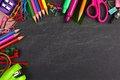 Chalkboard with school supplies corner border top on a background Stock Image