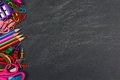 Chalkboard with school supplies side border Royalty Free Stock Photo