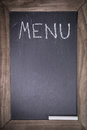 Chalkboard with wooden frame for restaurant with written text menu layout template background Royalty Free Stock Photo