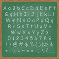 Chalked alphabet on a chalkboard background vector illustration of Royalty Free Stock Image