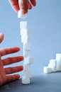 Challenge to higher a concept of stacking sugar cube Royalty Free Stock Images