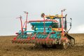 Challenger mt c tracked tractor drilling seed in field a modern caterpillar pulling drill ploughed Royalty Free Stock Image