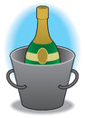 Chamagne in bucket bottle of champagne chilling ice Royalty Free Stock Images