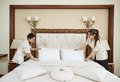 Chambermaid woman team at hotel service Royalty Free Stock Photo
