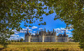 Chambord castle the famous located in the loire valley in a summer day framed by beautiful green trees from the hunting ground Stock Images
