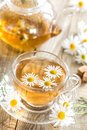 Chamomile tea herbal in a cup and fresh flowers Royalty Free Stock Images