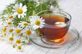 Chamomile tea on wooden table Royalty Free Stock Photo