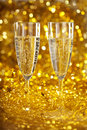 Champagne against the gleaming bokeh Royalty Free Stock Image