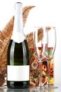 Champagne bottle with blank label, empty glasses Royalty Free Stock Images