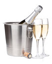 Champagne bottle in bucket and two glasses isolated on white background Royalty Free Stock Images
