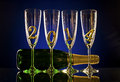 Champagne bottle with four glass goblet and numeral beautiful celebrations new year concept photo Royalty Free Stock Photo