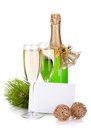 Champagne bottle, glasses and empty card Royalty Free Stock Image
