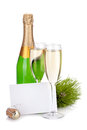 Champagne bottle, glasses and empty card Royalty Free Stock Images
