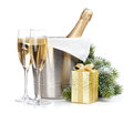 Champagne bottle in ice bucket, two empty glasses and christmas Royalty Free Stock Photo