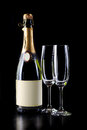 Champagne bottle and two glasses Stock Photography