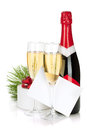 Champagne, christmas gift and empty greeting card Royalty Free Stock Image