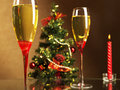 Champagne christmas tree and candle two glasses of wine on the background of the Stock Photography