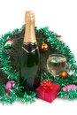 Champagne and christmas tree decorations a bottle of the wine glass on the background of decorating fir branches ornaments Royalty Free Stock Photos
