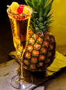 Champagne  cocktail with cherry and pineapple Royalty Free Stock Photo