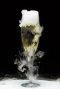 Champagne flute with ice vapor black background Royalty Free Stock Photo