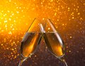 Champagne flutes on golden light bokeh background make cheers Stock Photo